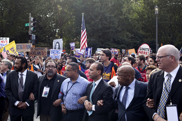 WASHINGTON, DC - Oct. 08 A group of civil rights leaders and faith leaders including Rep. Luis Gutierrez (center) march toward the U.S. Capitol during March for Immigrant Dignity and Respect held at the National Mall in Washington, DC Tuesday October 8, 2013. The group would later be arrested by police. (Photo by Jared Soares for MSNBC)
