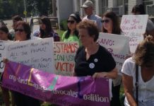 Three dozen marched in Mineola for language access.